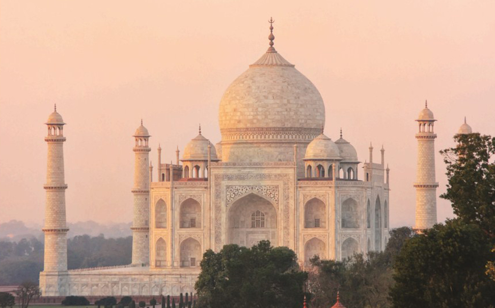 An unusual view of sun kissed Taj Mahal glowing breight and flawlessly - Marshalls