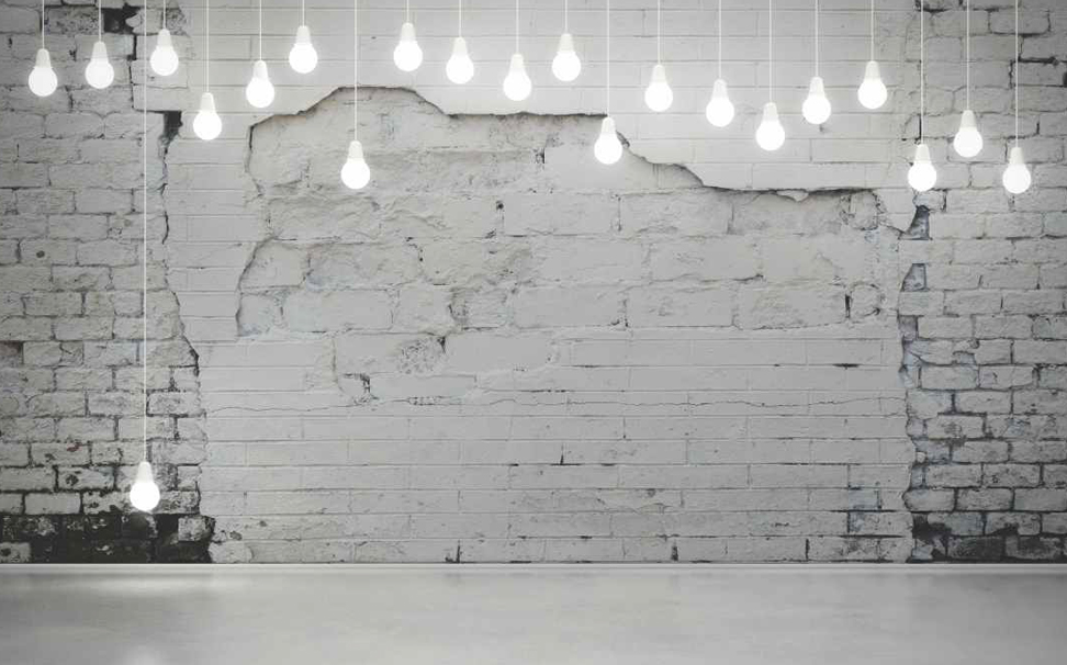 Aged weathered white brick wall with cuddle-up string lights Abstract Wallcoverings - Marshalls