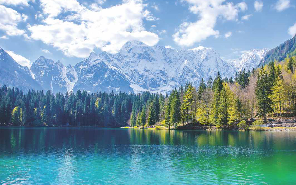 Beautiful turquoise lake water with snowy mountains wallpaper - Marshalls