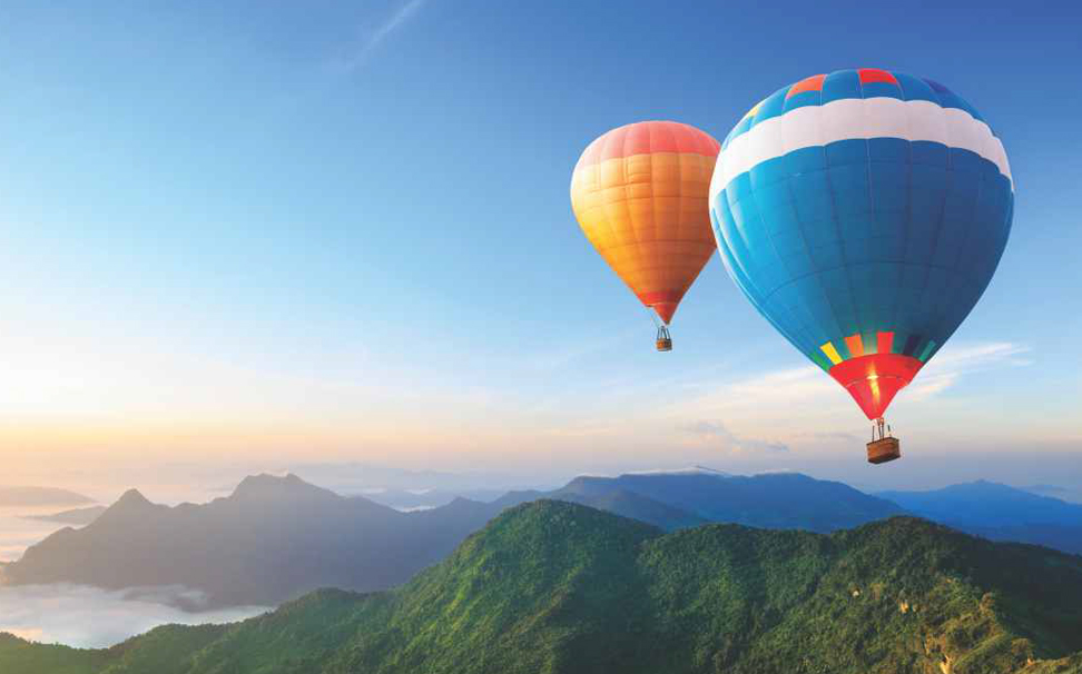 Hot air balloons flying over the mountain wallpaper - Marshalls